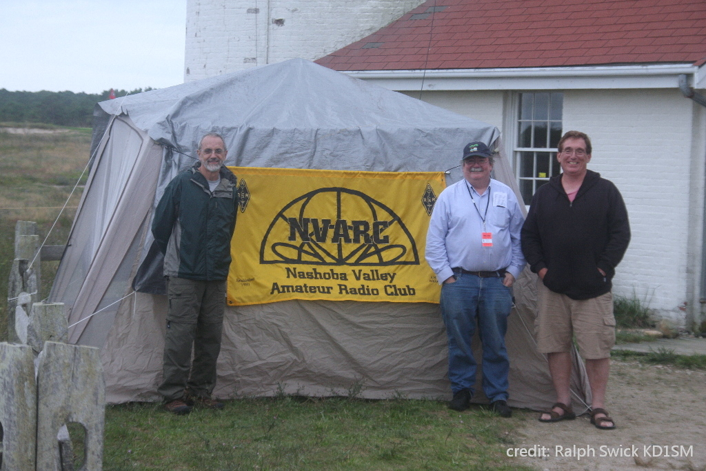 Jim K1PTF, Roland NR1G, and Bruce K1BG in front of NVARC banner